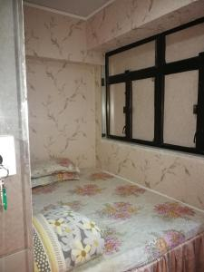 A bed or beds in a room at Lucky Hostel