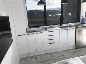 A kitchen or kitchenette at Simply Stunning Studio 2 Apartment - sleeps two
