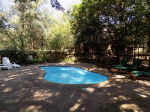 The swimming pool at or near Phumula Kruger Lodge and Safaris