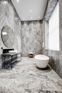 A bathroom at Nobis Hotel Copenhagen, a Member of Design Hotels™