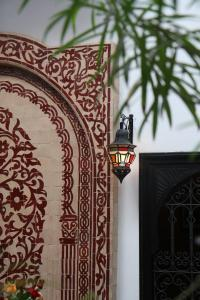 The logo or sign for the riad