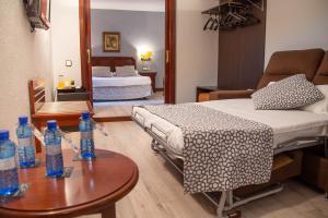 Säng eller sängar i ett rum på Soho Los Naranjos