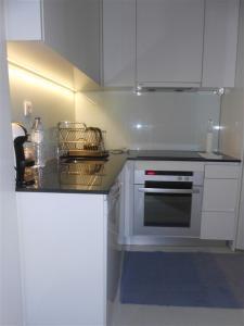 A kitchen or kitchenette at CASA DA ALAMEDA - 2oANDAR
