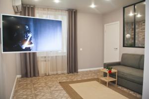 Телевизор и/или развлекательный центр в Апартаменты Уфа-Арена