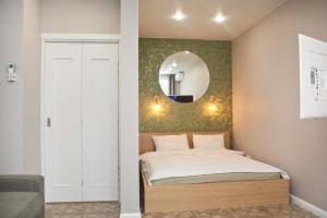Кровать или кровати в номере Апартаменты Уфа-Арена