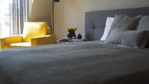 A bed or beds in a room at Tartaczna Street Apartment