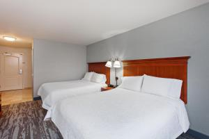 A bed or beds in a room at Hampton Inn & Suites Clovis