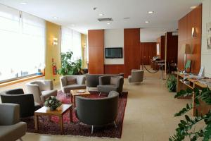 The lobby or reception area at MH Hotel Piacenza Fiera