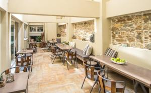 A restaurant or other place to eat at Diogenis Hotel