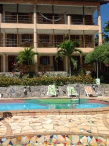 The swimming pool at or close to Hotel e Pousada Tropical Wind do Cumbuco