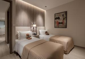 A bed or beds in a room at Le Grove Serviced Residences (SG Clean)