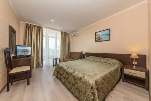 Кровать или кровати в номере Hotel Grand Kruiz