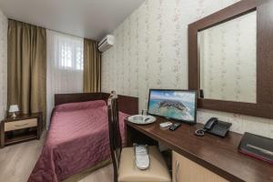 Телевизор и/или развлекательный центр в Hotel Grand Kruiz