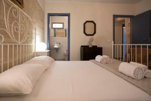 Letto o letti in una camera di Luxury Favignana Villa