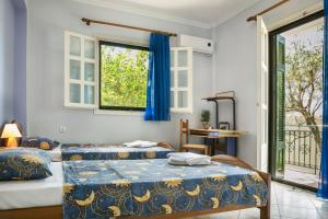 A bed or beds in a room at Apartment Voula Myrtos