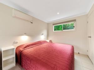 A bed or beds in a room at NRMA Port Campbell Holiday Park