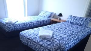A bed or beds in a room at Grange Water View Yarrawonga