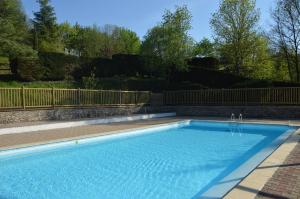 The swimming pool at or near Camping l'Oasis