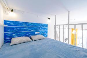 Кровать или кровати в номере Sokroma Алые Паруса Aparts