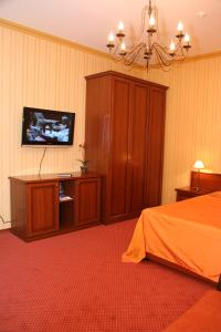 A television and/or entertainment center at Hotel Muskat