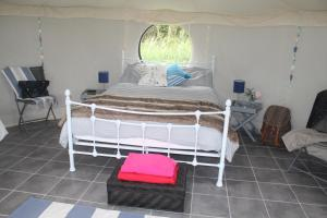 A bed or beds in a room at Woodyhyde