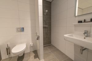 Ein Badezimmer in der Unterkunft De Pelikaan Texel
