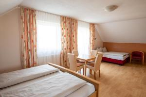 Ein Bett oder Betten in einem Zimmer der Unterkunft Appartementhaus Badria