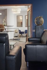 Ein Sitzbereich in der Unterkunft City Hotel