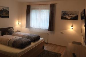 Ein Bett oder Betten in einem Zimmer der Unterkunft Alp Chalet Appartement