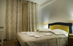 A bed or beds in a room at Maisonette House Minos