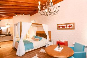 A bed or beds in a room at Hotel Cabanas Tio Müller