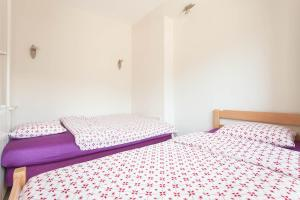 A bed or beds in a room at Tina Apartments