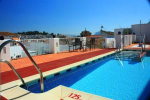 The swimming pool at or near Hotel Infante Antequera