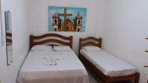 A bed or beds in a room at Hostel Pelourinho