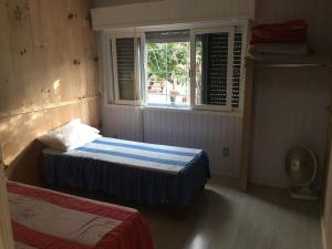 A bed or beds in a room at Apartamento Terreo em Caxias do Sul