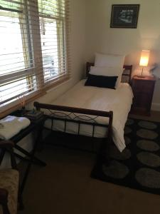 A bed or beds in a room at Riverleigh