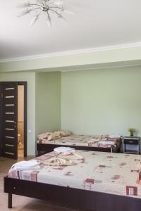 Кровать или кровати в номере Гостевой Дом «VAN»