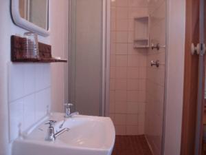 A bathroom at Bay Cove Inn