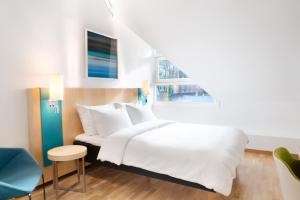 A bed or beds in a room at Radisson Blu Royal Hotel, Bergen