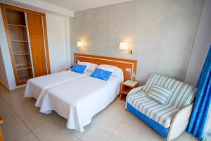 A bed or beds in a room at Hotel Don Pablo