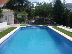 The swimming pool at or near Casa Fátima Vivienda turística de alquiler rural