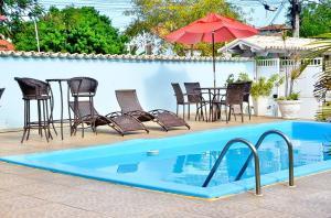 A piscina localizada em Pousada Ancora de Ouro ou nos arredores