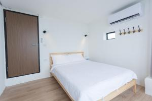 A bed or beds in a room at No. 55 Hostel