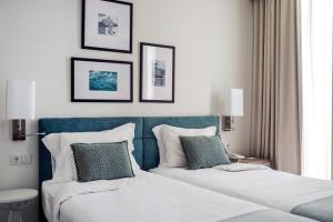 A bed or beds in a room at Grande Hotel De Luso
