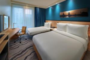 A bed or beds in a room at Hampton by Hilton Berlin City Centre Alexanderplatz