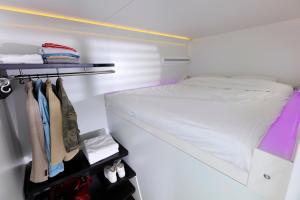 Un ou plusieurs lits dans un hébergement de l'établissement CityHub Amsterdam
