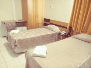 A bed or beds in a room at Seamar Hotel