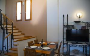A television and/or entertainment centre at Maisonette House Minos