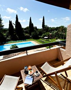 A view of the pool at Najeti Golf Hôtel de Valescure or nearby