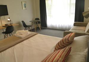 A bed or beds in a room at Ballina Byron Islander Resort and Conference Centre